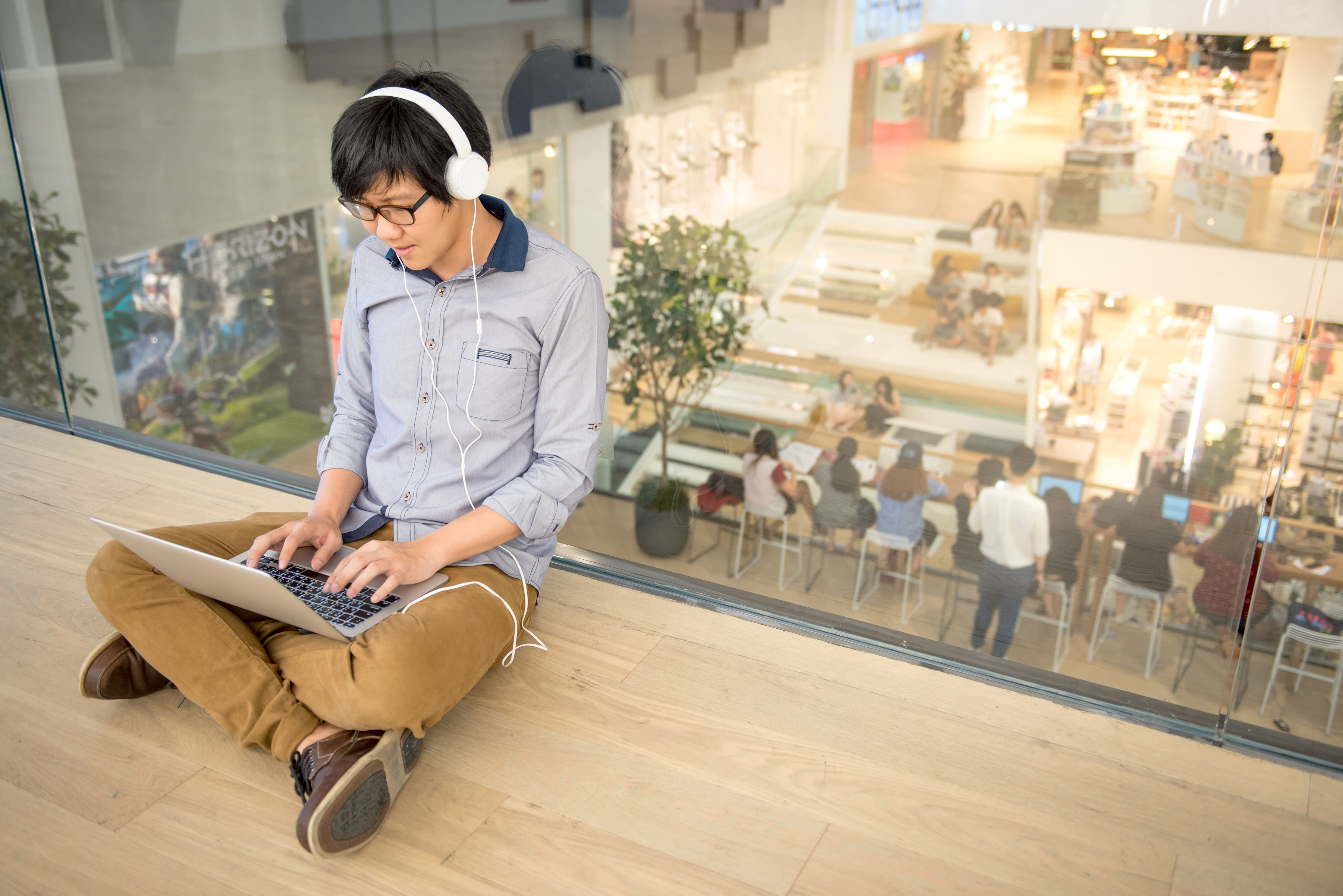 Young man needing privacy in a co-working space
