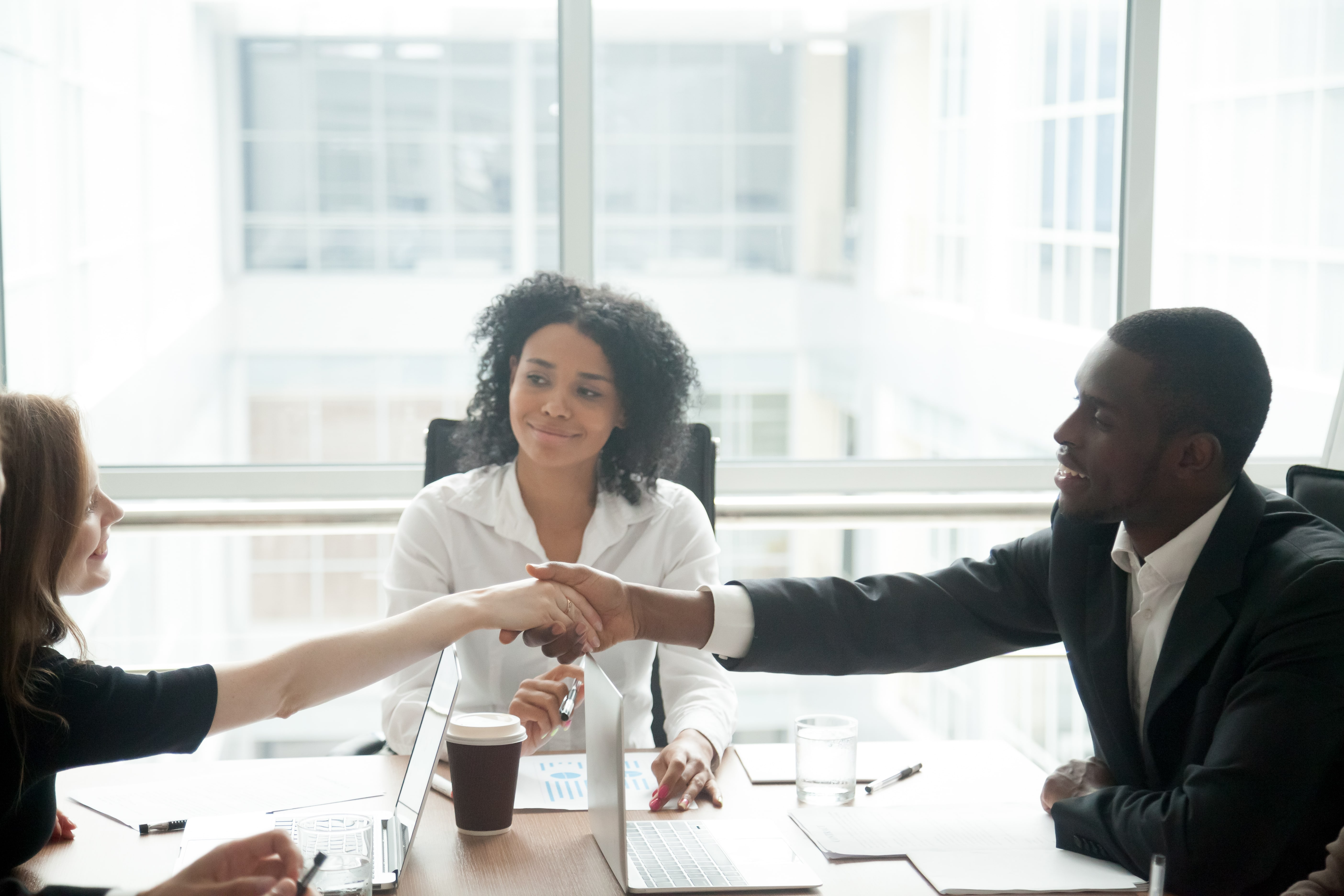 Manager using conflict resolution skills to help employees come to an agreement