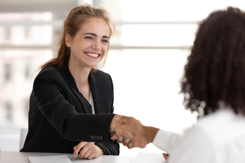 HR Professional shaking hands after discussing health benefits